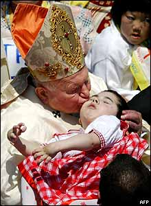 Pope kisses small child