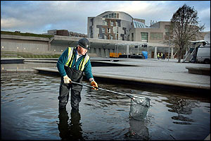 The final touches are put to the area around Holyrood in advance of the formal opening by the Queen on Saturday
