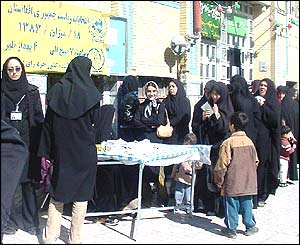 Afghans vote at a polling station in Iran