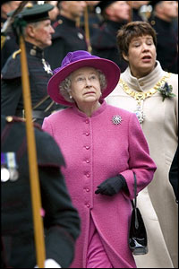 Outside, something above the Royal Mile catches the Queen's attention as she heads for a dais from which to watch the Riding
