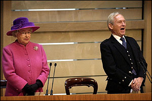 Presiding Officer George Reid gives a hearty rendition of Auld Lang Syne while the Queen looks a little less sure