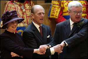 The Duke of Edinburgh joins in Auld Lang Syne with MSPs Trish Godman and Murray Tosh