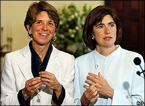 Hillary (L) and Julie Goodridge (R) display their rings after their marriage ceremony