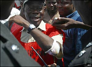 NLC President Adams Oshiomhole is blocked by Nigerian police trying to stop a rally in Abuja