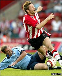 James Beattie is challenged by Matthew Le Tissier