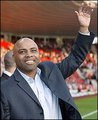 Danny Wallace salutes the crowd before the start of the testimonial