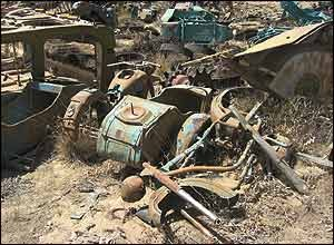A Soviet era motorcycle used by the soldiers lies in the heap.