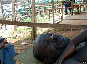 Man sleeps in a deserted market in Abuja