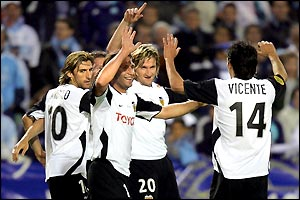 Valencia's delighted players celebrate a 2-0 win that ensures a Uefa cup and Spanish league double