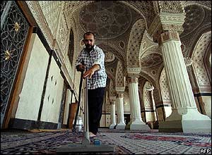 An Iraqi man cleans the carpet at a mosque in Baghdad.