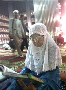 A Muslim woman reads the Koran at Istiqlal Mosque in Jakarta, Indonesia.