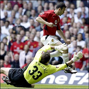 Ryan Giggs fails to connect with a long ball as Manchester United go on the attack from the off