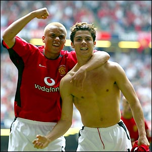 Wes Brown rushes to congratulate Ronaldo after the young Portuguese puts his side ahead just before half-time