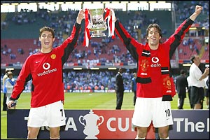 Man Utd's delighted goalscoring heroes Ronaldo and van Nistelrooy show off the silverware