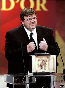 US director Michael Moore accepts the Palme d'Or