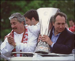 Liverpool chairman David Moores and manager Gerard Houllier hold the Uefa Cup on an open top bus parade