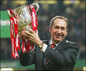 Gerard Houllier holds the Carling Cup aloft after Liverpool beat Manchester United in the 2003 final
