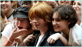 Rupert gets mobbed by the crowd. He looks a bit frightened!
