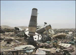 The remains of a helicopter crash lies in a valley near the Kabul - Jalalabad road.