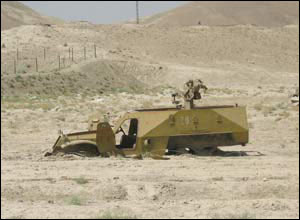 An army truck which has been rusting in the desert for years