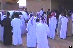 Scene from Iraq wedding video - the bride leaves home