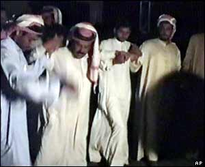 Scene from Iraq wedding video - men perform a Dabkeh dance