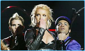 Britney on stage with her dancers
