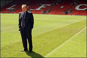 Gerard Houllier poses in front of the Kop