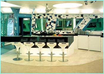 The kitchen. Those seats don't look too comfortable and the artwork's enough to give you a headache!