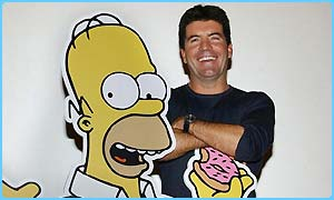 Simon Cowell with a model of Homer Simpson
