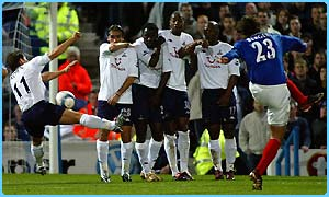 Michael Brown of Tottenham Hotspurs FC gifts Patrik Berger of Portsmouth FC a second free kick as he hand-balls during the match
