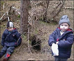 Mike Roberts' sons Ethan and Cole by a foxes den in Newborough Forest