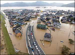 Houses are seen submerged in water in Toyooka, western Japan Thursday, Oct. 21, 2004.