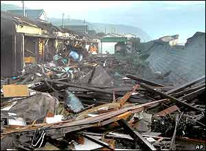 Debris are seen in Muroto, south-western Kochi prefecture Wednesday, Oct. 20, 2004 after massive waves destroyed breakwater and slammed into the coastal area.