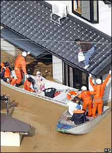 Isolated residents in Toyooka, western Japan are rescued by firefighters Thursday, Oct. 21, 2004.
