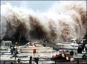 A billow caused by Typhoon Tokage clashes against a seawall in a harbour in Beppu, Oita Prefecture, south-western Japan, Wednesday morning, Oct. 20, 2004.