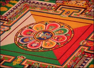 At the heart of the mandala is a traditional representation of a thunderbolt, the symbol of the Mitrukpa Buddha.