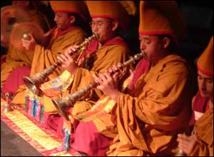 Less than a day after finishing their work, the monks are back to play traditional Tibetan instruments, and pray.