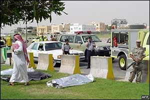 Covered bodies lie on grass verge in Khobar