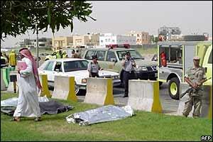 Covered bodies lie on grass verge in Khobar