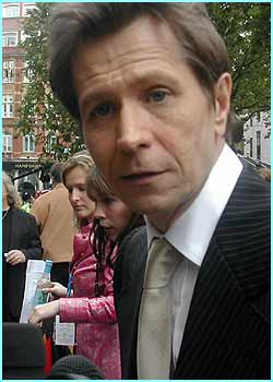 Gary Oldman looks much smarter than straggly old Sirius Black in real life...