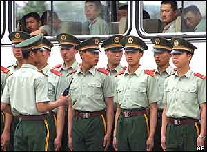 Chinese paramilitary police prepare to patrol in Beijing's Tiananmen Square,  June 4, 2004