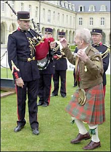 Ex-Royal Signalman William Young, from Glasgow, danced a jig for a French piper