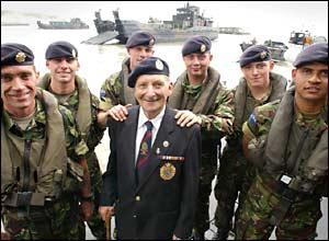 Former sapper Cyril Ager, 79, with soldiers