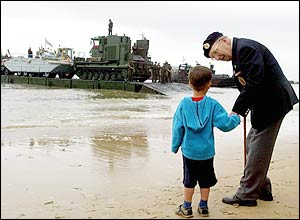 Cyril Ager, 79, a Royal Engineer in the war talks to four-year-old Michael Sheehan from Maidenhead, as they watch the Army's 17 Port and Maritime Regiment ramps boats dock.