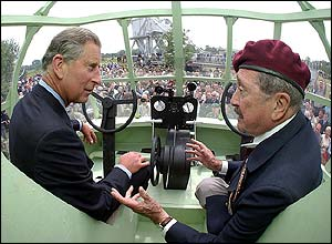 Prince Charles sits with veteran pilot Jim Wallwork inside a replica of one of the giant gliders used in the daring raid on Pegasus Bridge 60 years ago.