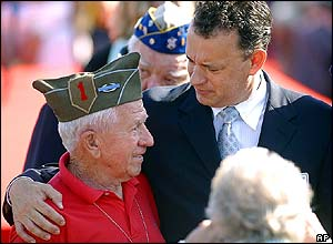 US actor Tom Hanks chats with a WWII veteran at the US cemetery in Colleville-sur-me