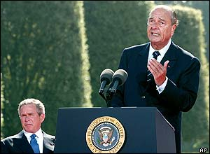French President Jacques Chirac delivers his speech as U.S. President George W. Bush, left, listens on during a ceremony at the American Cemetery