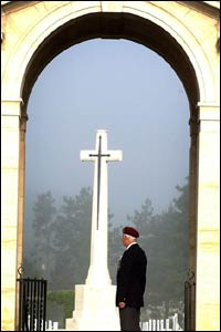 A veteran looks on in remembrance at the Ranville cemetery