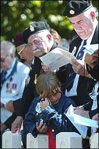 One young visitor is overcome as veterans look on